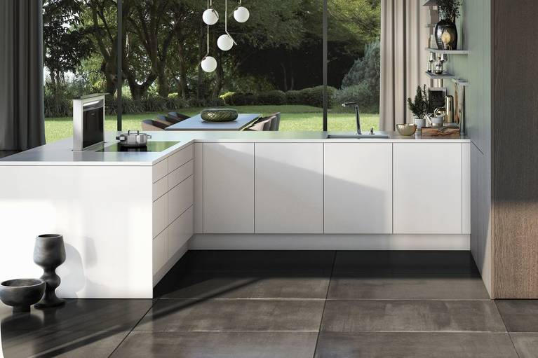 "SieMatic Pure SE base cabinets in glossy lotus white ""SQ lacquer"" with downdraft extractor"