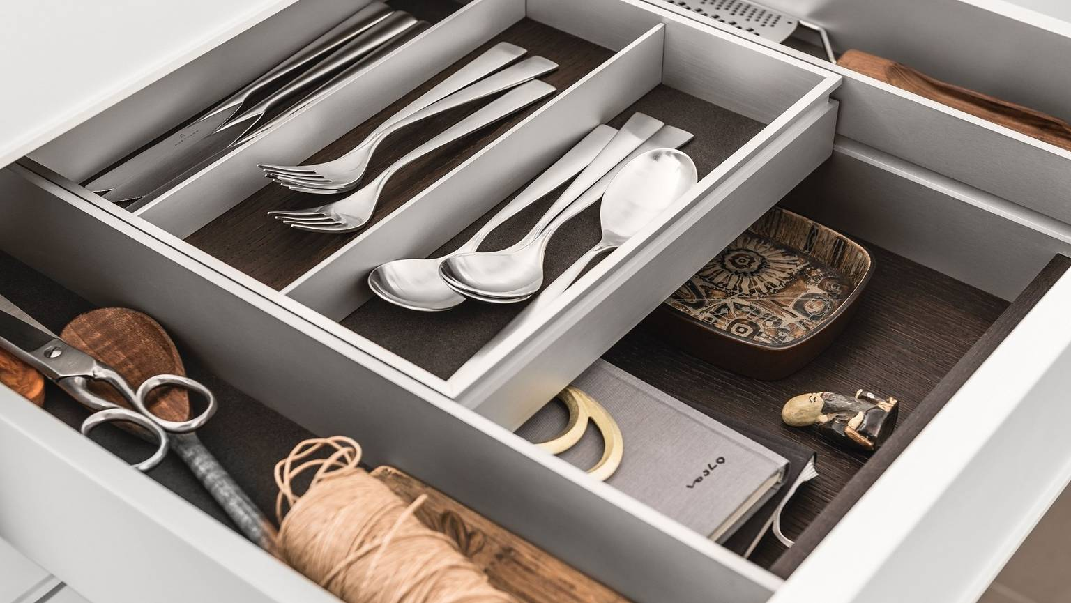 A bi-level drawer elegantly doubles storage space in SieMatic kitchen drawers and pull-outs