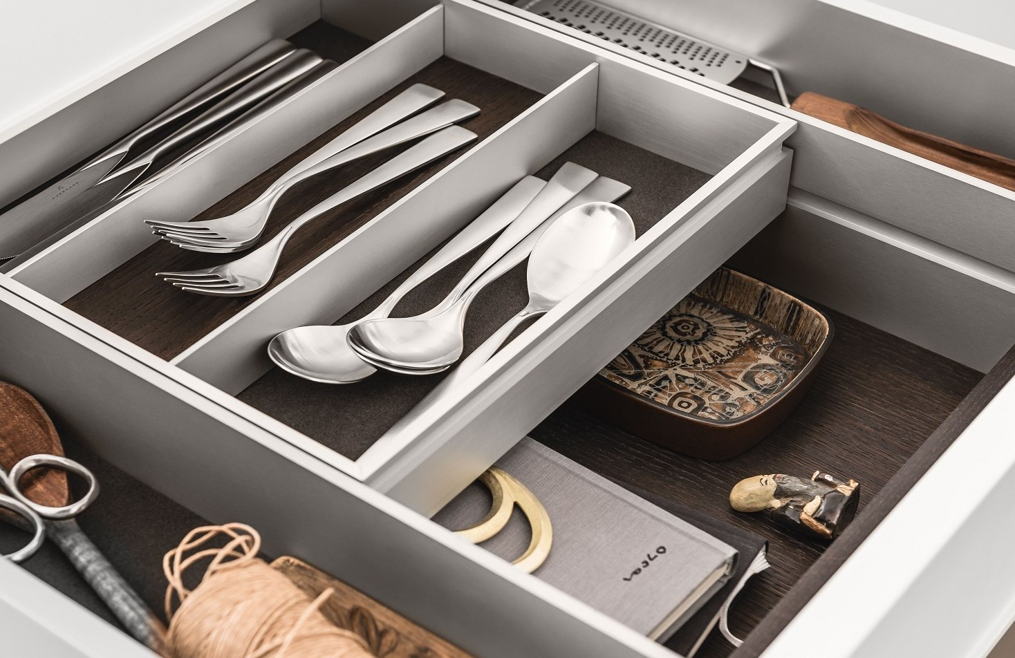 A bi-level drawer elegantly doubles storage space in SieMatic kitchen drawers