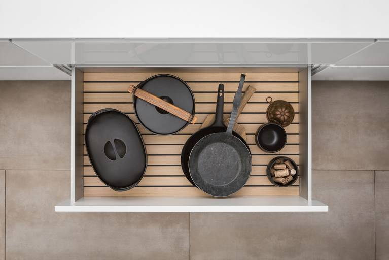 Pots and pans on GripDeck in light oak from SieMatic wooden kitchen accessories