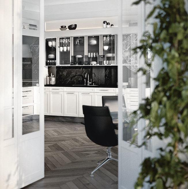 SieMatic Classic BeauxArts keuken onderkasten in glanzend lotuswit en een nis van zwart marmer.
