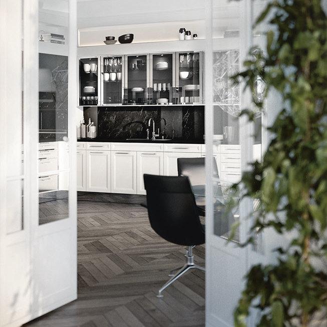 SieMatic Classic BeauxArts SE basi in bianco loto lucido con rivestimento nicchia in marmo nero.