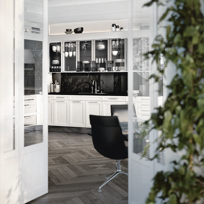 SieMatic Classic BeauxArts SE avec meubles bas de cuisine en blanc lotus brillant, habillage des niches en marbre noir.