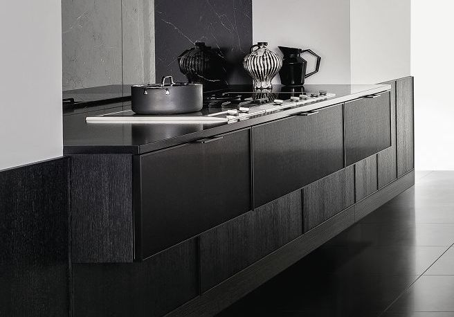 SieMatic Pure SE 3003 R kitchen with brushed metal door fronts and side panels in black matte oak