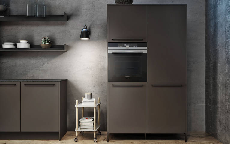 Freestanding tall cabinet in umbra with oven is a functional addition to urban design with SieMatic 29