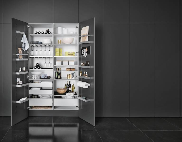 With SieMatic MultiMatic interior accessories, gain up to 30% more storage space in tall, wall and base cabinets.