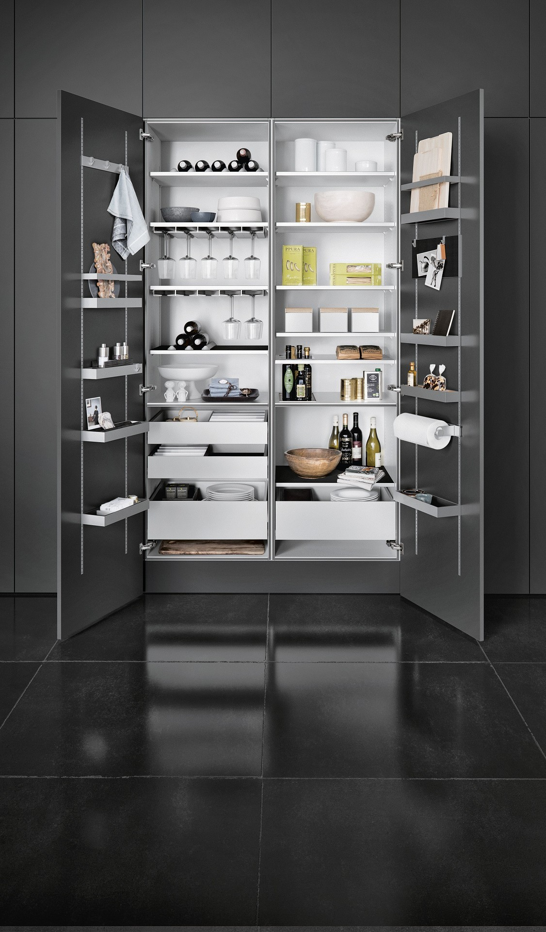 SieMatic MultiMatic interior organization system for tall cabinets offers storage space for jars, glasses, dinnerware and supplies
