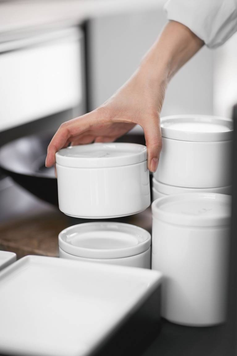 Stackable porcelain containers by SieMatic optimize storage in the kitchen
