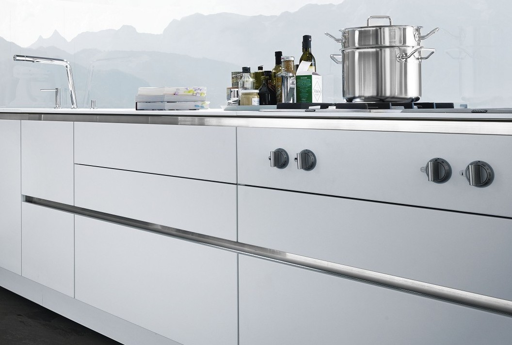 SieMatic S2 base cabinets in lotus white gloss with handle channel in the Pure style collection