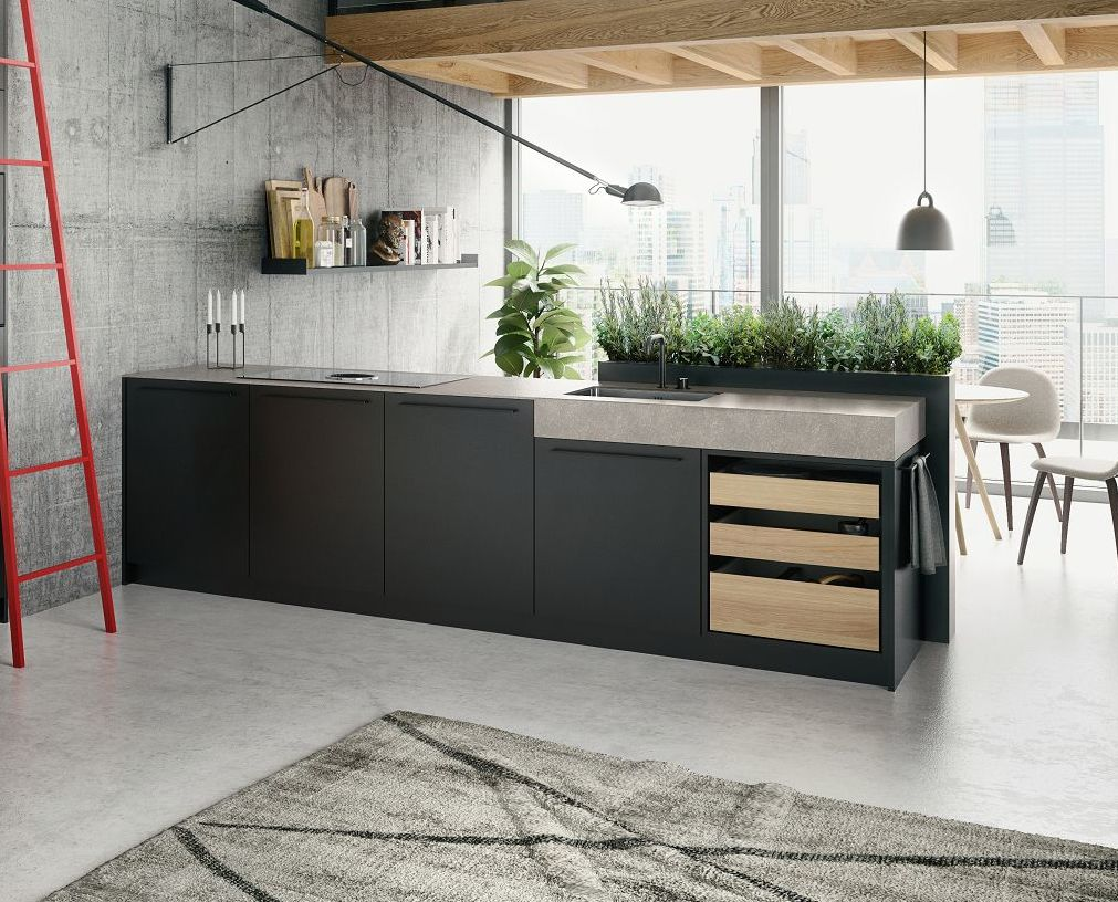 Ilot de cuisine design loft SieMatic Urban SE en gris avec extensions ouvertes et placage en bois de chêne sable et hotte aspirante.