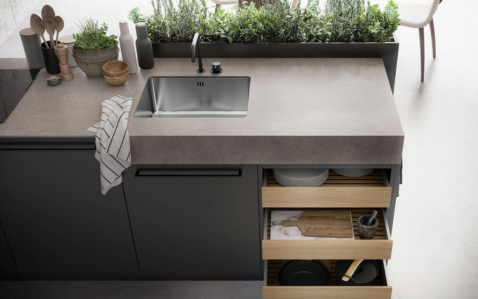 Kitchen island with SieMatic StoneDesign countertop and herb garden from the Urban style collection