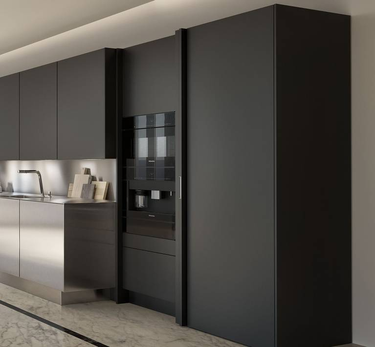 Kitchen appliances can hide behind retractable pocket doors by SieMatic.