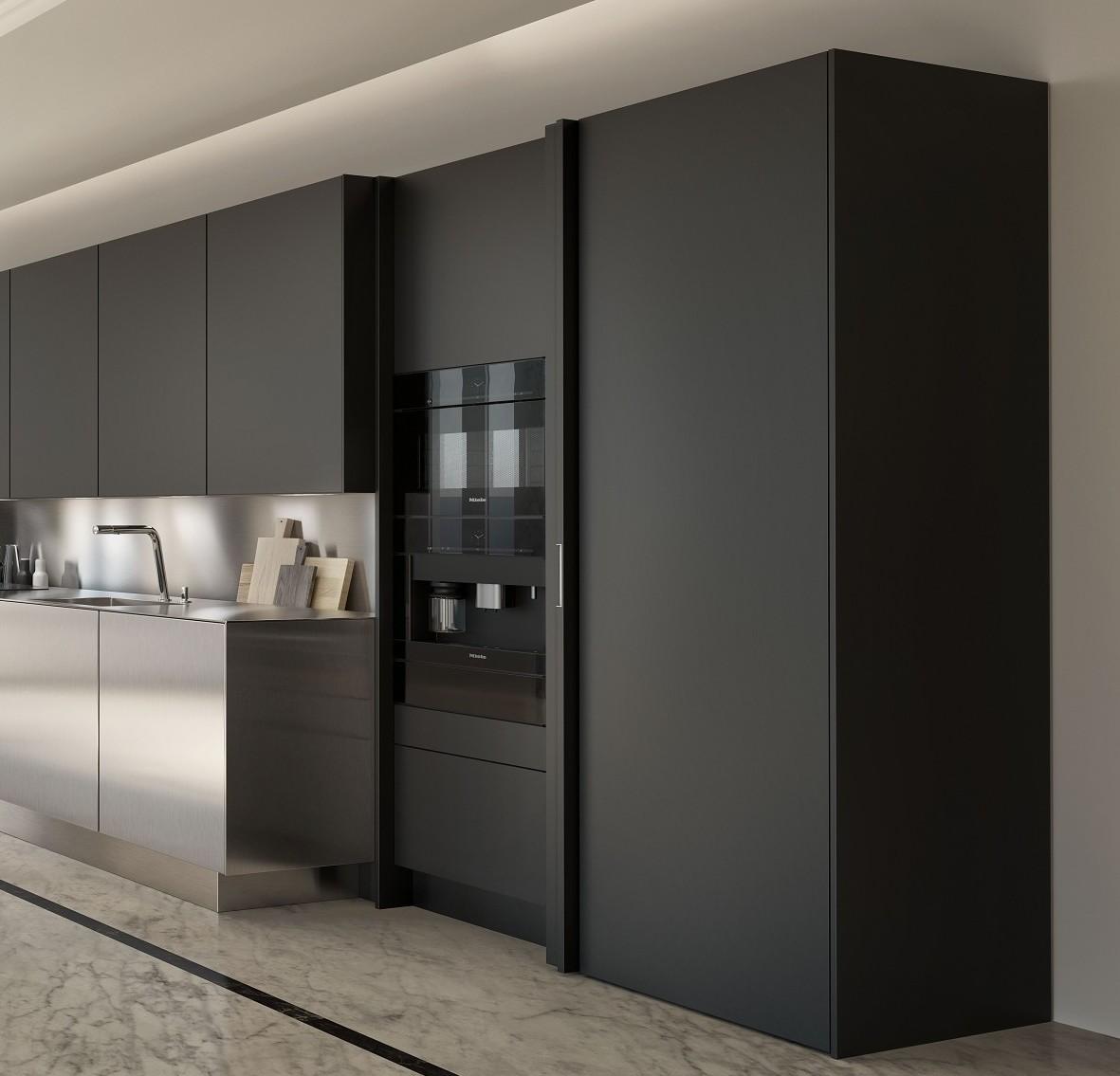 Les appareils électriques et ustensils de cuisine peuvent être dissimulés grâce aux cabinets latéraux escamotables SieMatic.