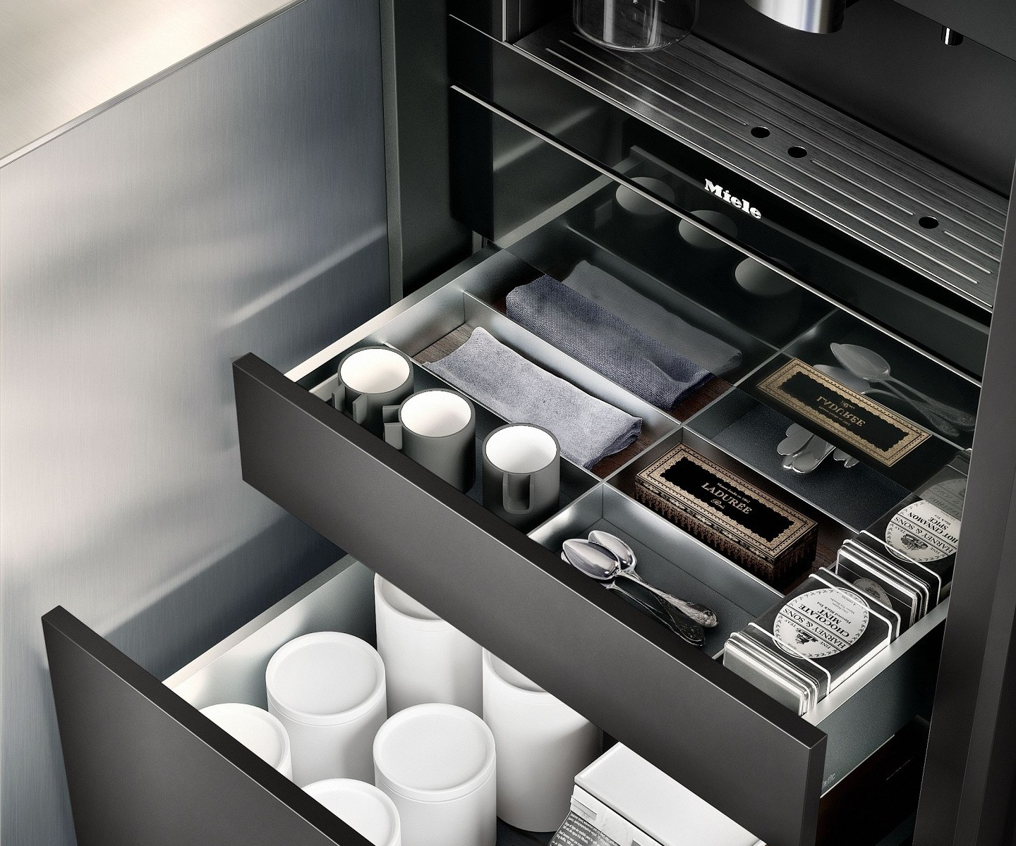 Porcelain containers and cutlery inserts from the SieMatic Aluminum Interior Accessories System for kitchen drawers