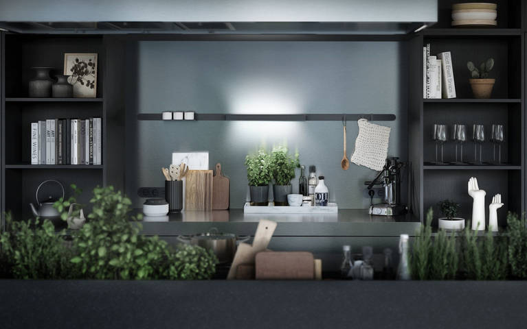 SieMatic Urban SE kitchen island in graphite oak and stainless steel with herb garden and StoneDesign granite countertop