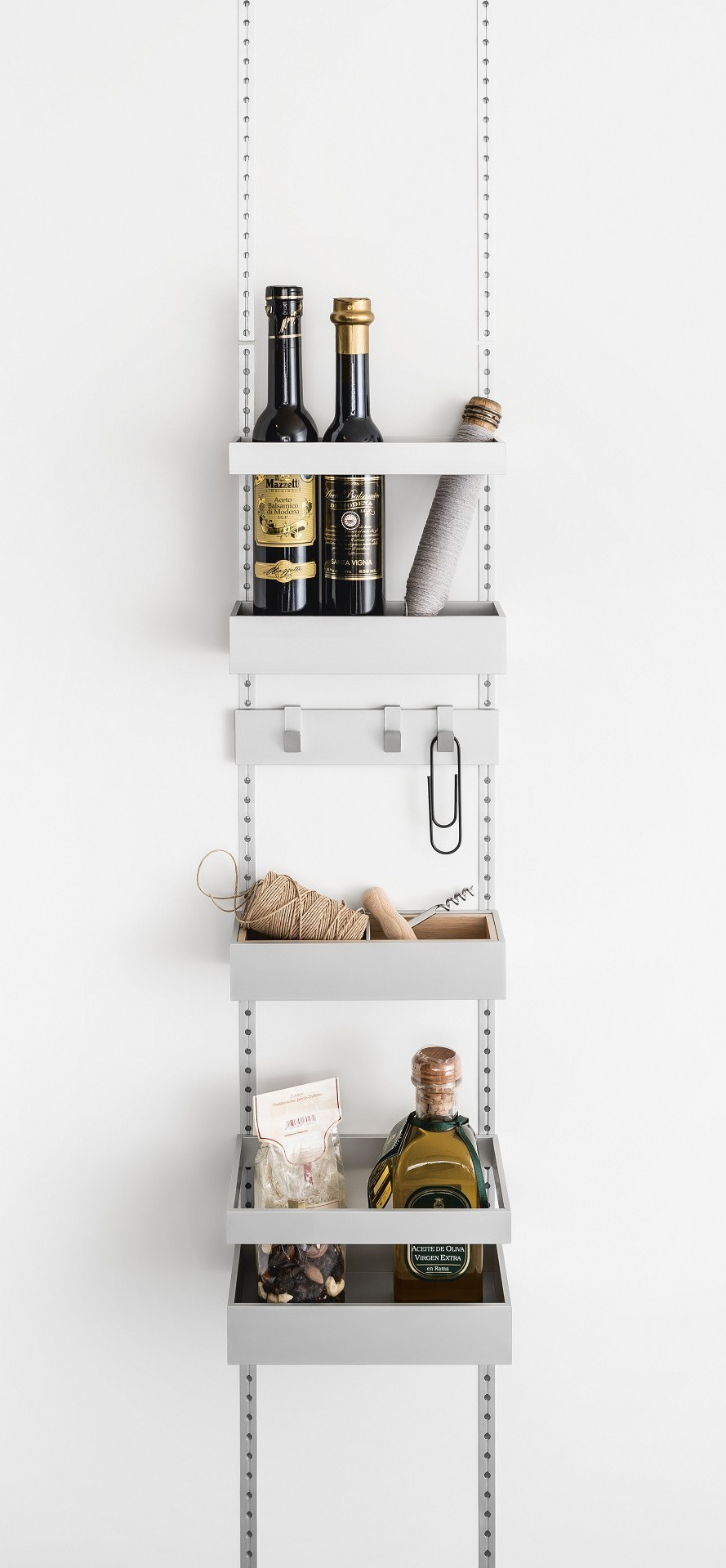 Storage trays and hook railing in the SieMatic MultiMatic interior organization system for jars, boxes and small items - even for narrow cabinet doors