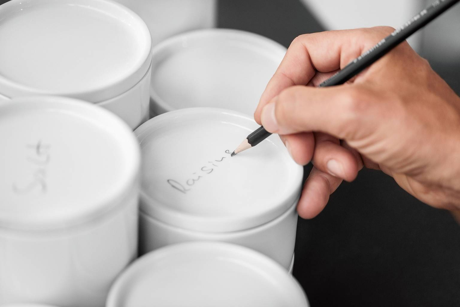White SieMatic porcelain containers individually labeled in pencil