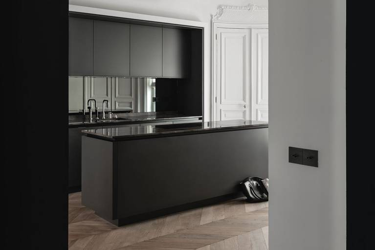 SieMatic Pure S2 kitchen island in graphite grey matte lacquer with a classic herringbone parquet wood floor