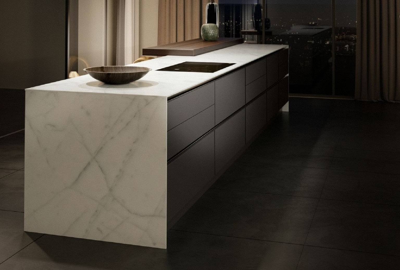 Minimalist kitchen design with handleless island, with SieMatic StoneDesign countertop and side panels in bright marble