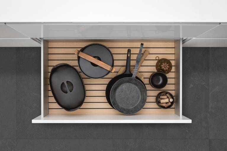 GripDeck inserts for SieMatic kitchen drawers and pull-outs prevent pots and pans from sliding.