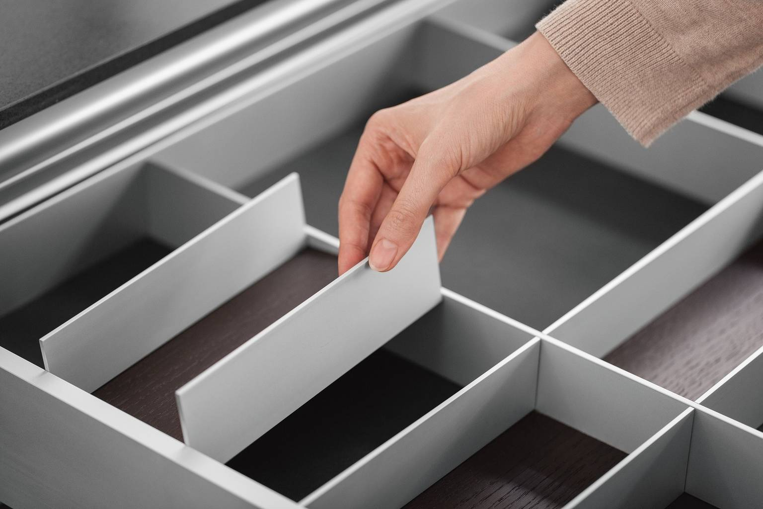 Cutlery inserts in aluminum from SieMatic interior organization accessories