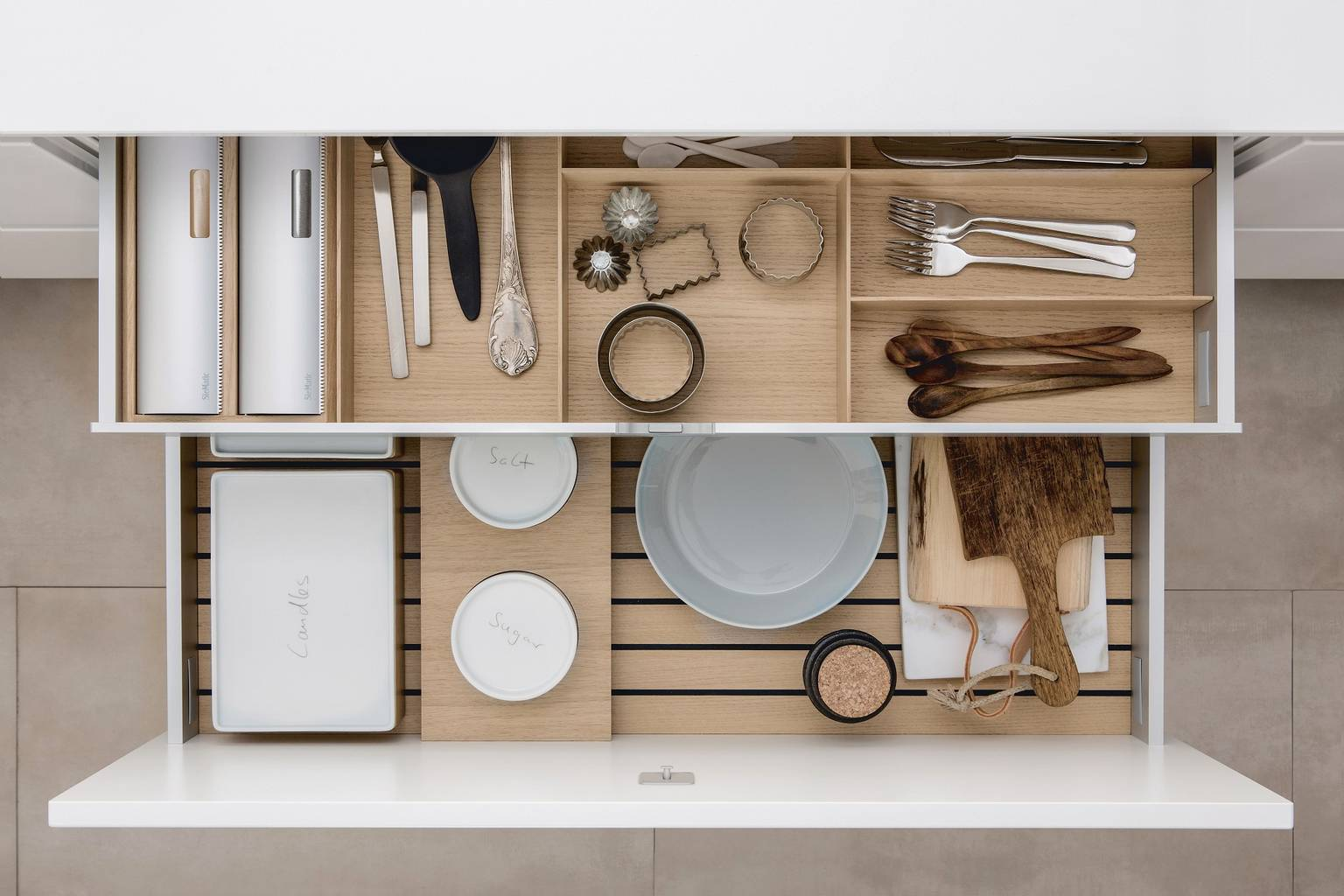 Versatile combination of SieMatic kitchen accessories in light oak wood