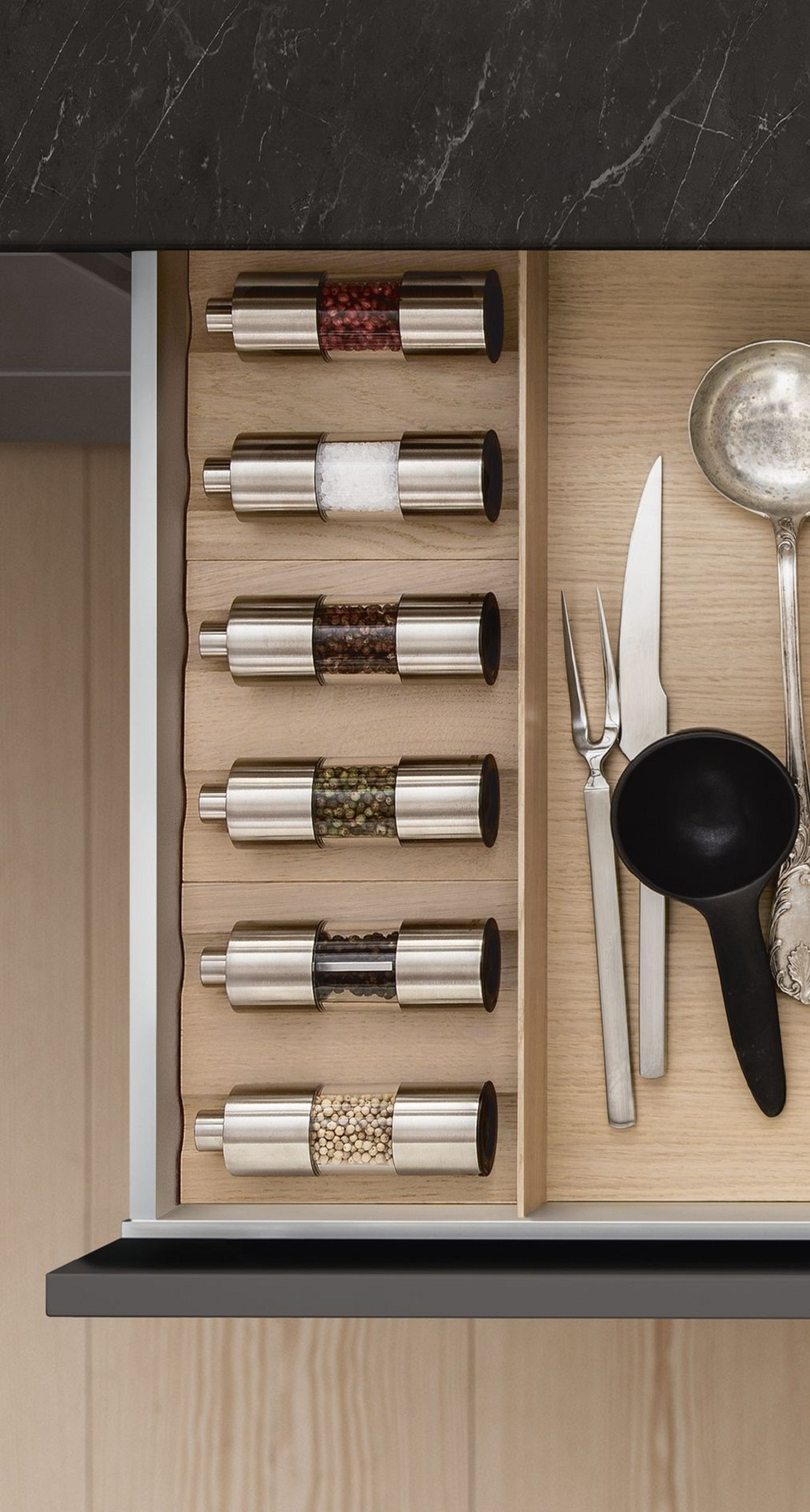 Spice mills from the SieMatic Wooden Interior Accessories System