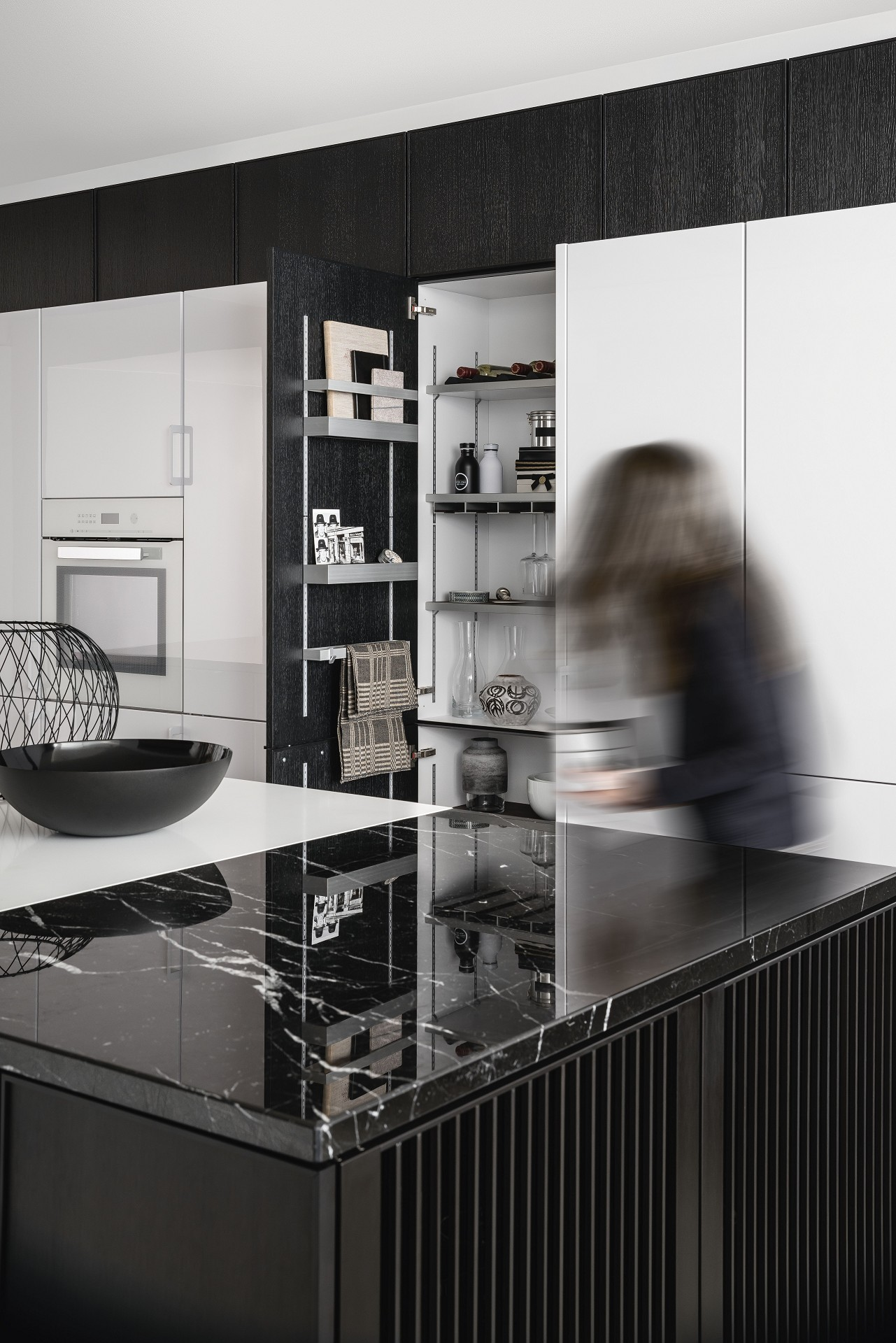 SieMatic Pure SE 3003 R kitchen cabinets in black matte oak with SieMatic MultiMatic interior organization system