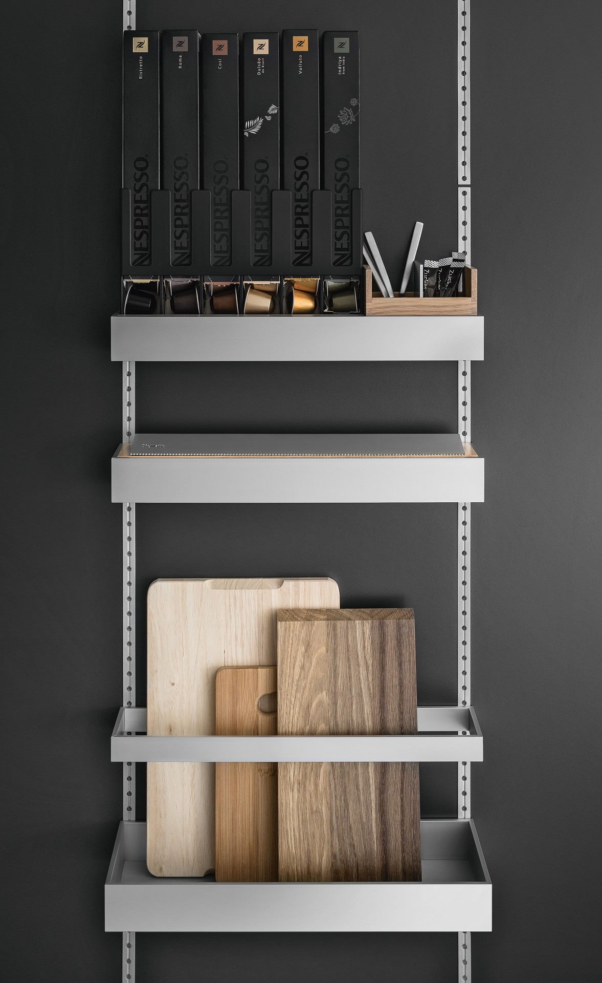 Coffee capsule organizer, foil roll tray and cutting board holder from the SieMatic MultiMatic interior accessories system