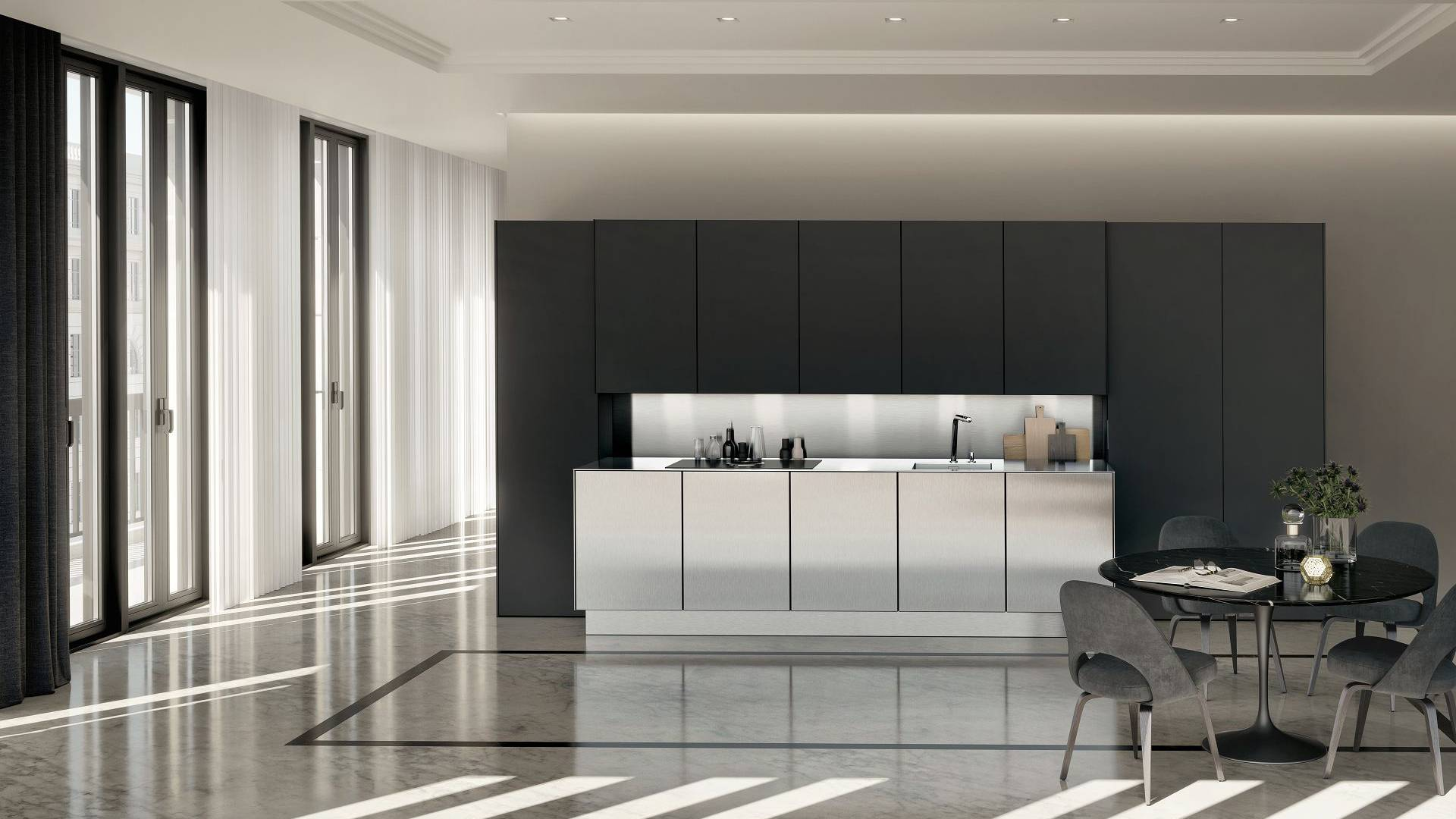 SieMatic Pure SE kitchen with tall and wall cabinets in graphite grey matte lacquer as well as base cabinets in stainless steel